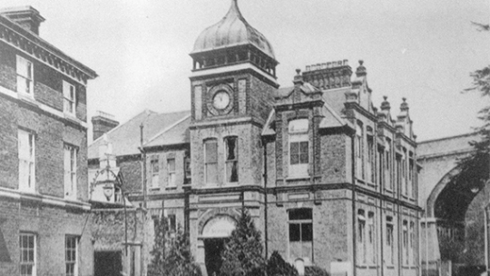 Historic black and white photo of the outside of a now BNU building