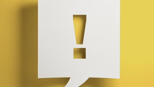 Exclamation mark against a yellow background