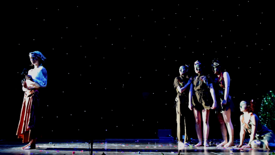 Performing Arts students in the middle of a show on stage