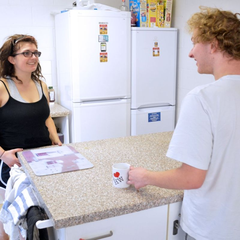 Two students in a shared kitchen