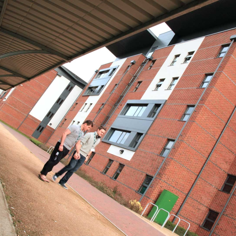 Two Bucks students walking outside Hughenden Park Student Village Accommodation