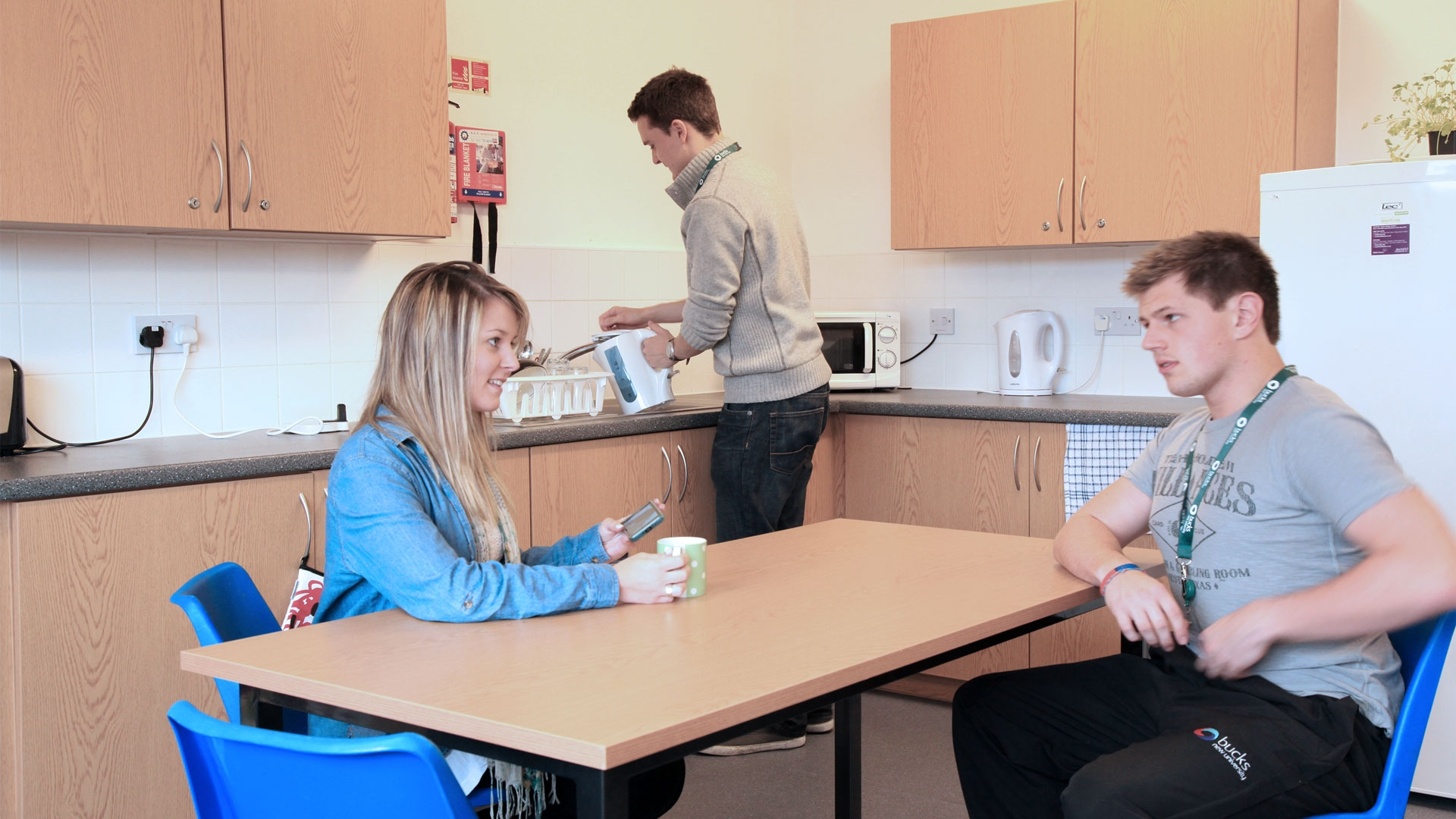 hree students in a communal kitchen at Hughenden Park Student Village